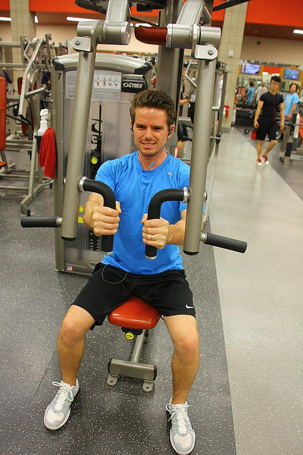 Brandon Hays, a junior in exercise and sports science pre med, works out at the Student Life Center on Wednesday night. Photo credit: Dane Goodwin