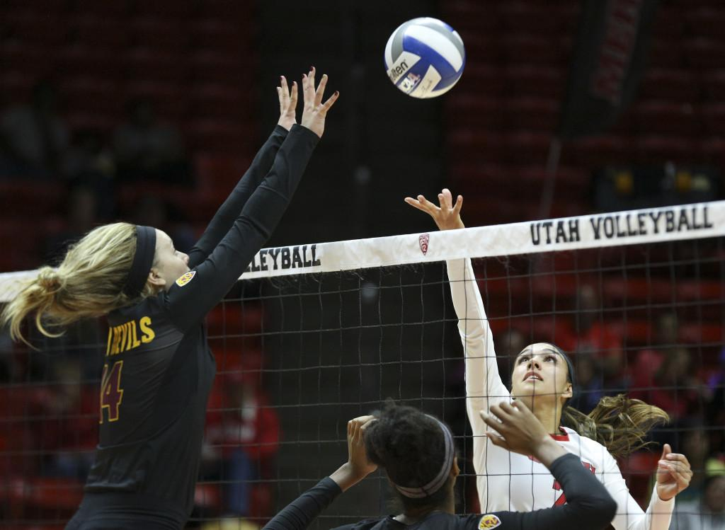 Sophomore outside hitter Eliza Katoa, right, tips the ball during a Pac-12 volleyball match against the Arizona State Sun Devils at the Jon M. Huntsman Center, Saturday, Nov 14, 2015. Photo by Chris Ayers.