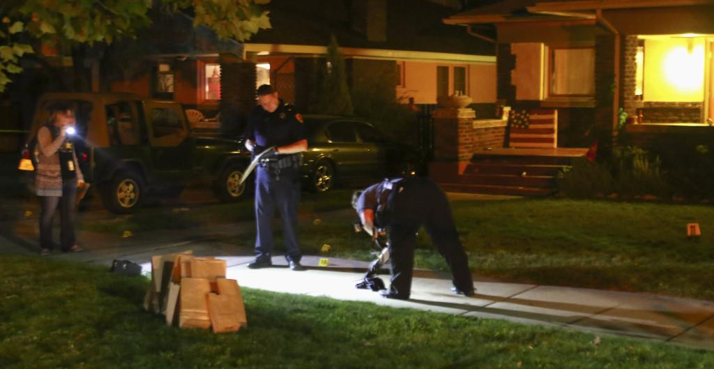Investigators review evidence after responding to a shooting involving two members of the U football team on 310 South 1300 East near campus, Sunday, Sept.13, 2015. Chris Samuels, Daily Utah Chronicle.