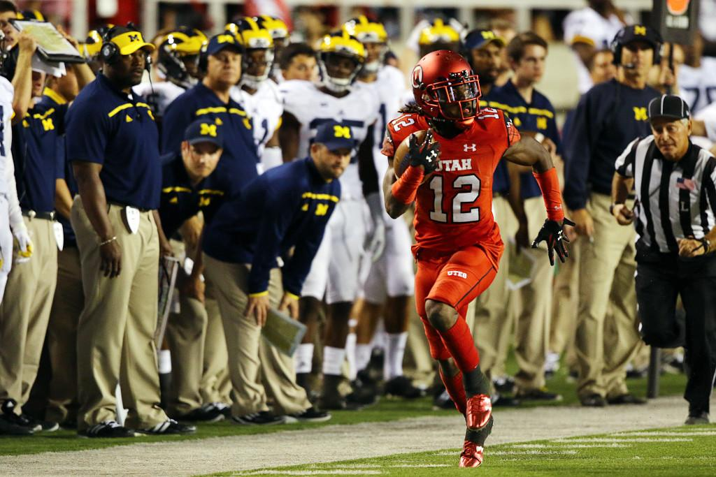 Junior nickel back Justin Thomas (12) runs toward the end zone after intercepting a pass in the second half against the Michigan Wolverines at Rice-Eccles Stadium, Thursday, September 3, 2015. Utah won the contest, 24-17. Chris Samuels, Daily Utah Chronicle.