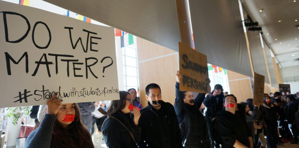 Protesters hold signs at a racial awareness march and discussion inside the Union Ballroom on Friday, Nov. 20th, 2015. Rishi Deka, Daily Utah Chronicle.