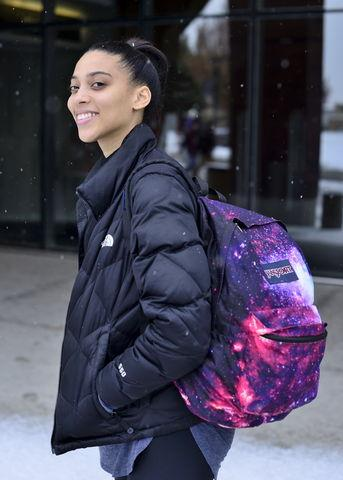 Sydney Duncan a senior double major in Physics and Ballet proudly shows her galaxy backpack to show her love of the cosmos at the Marriot Library on Thursday, Jan. 14, 2016.