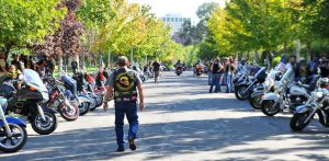A member of the Combat Veterans Motorcycle Association walks down between the parked bikes in Memory Grove after the culmination of the ride. Aug 27, 2016 Adam Fondren Daily Utah Chronicle