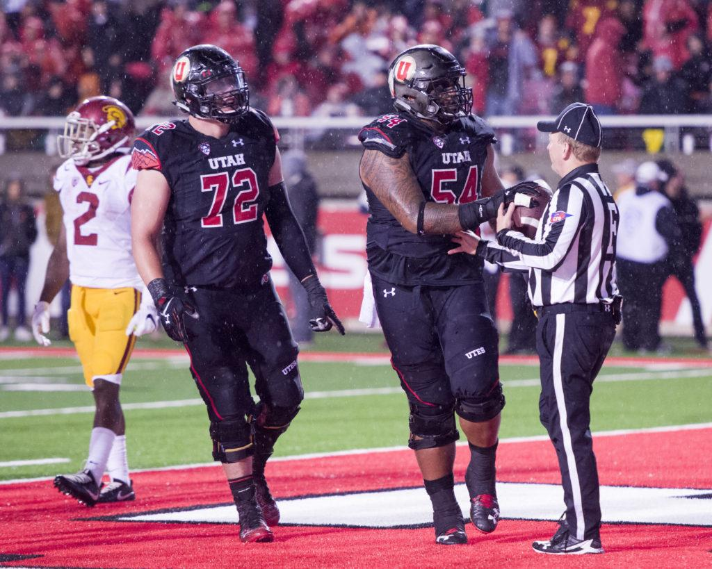 b0787192c University of Utah Football senior senior left guard Isaac Asiata (54)  hands the ball to the ref after the touchdown during the game vs. the  University of ...