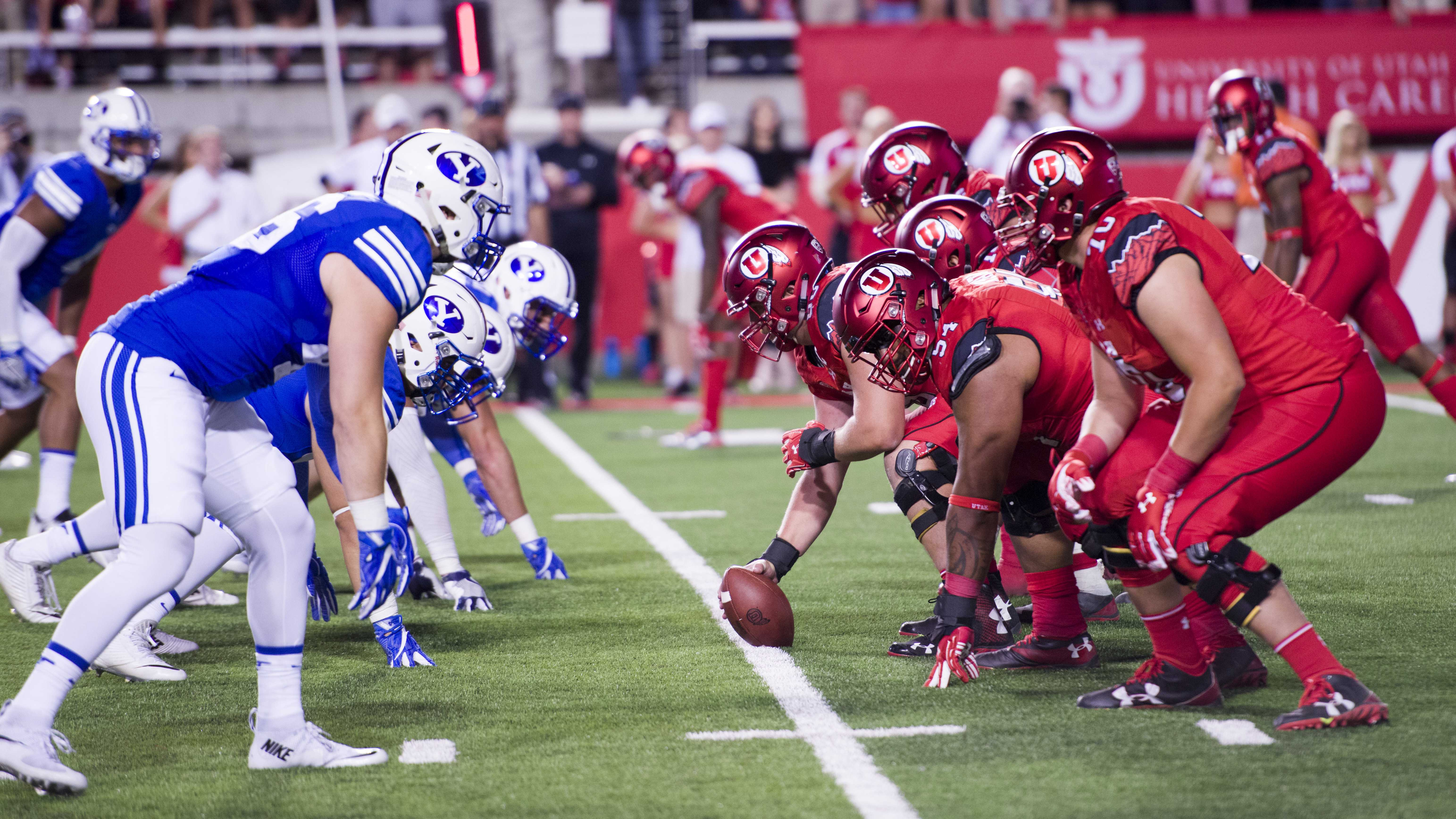 47d1bb3a4 University of Utah Football offense lines up before the snap during the game  vs. the Brigham Young University Cougars at Rice-Eccles Stadium on  Saturday