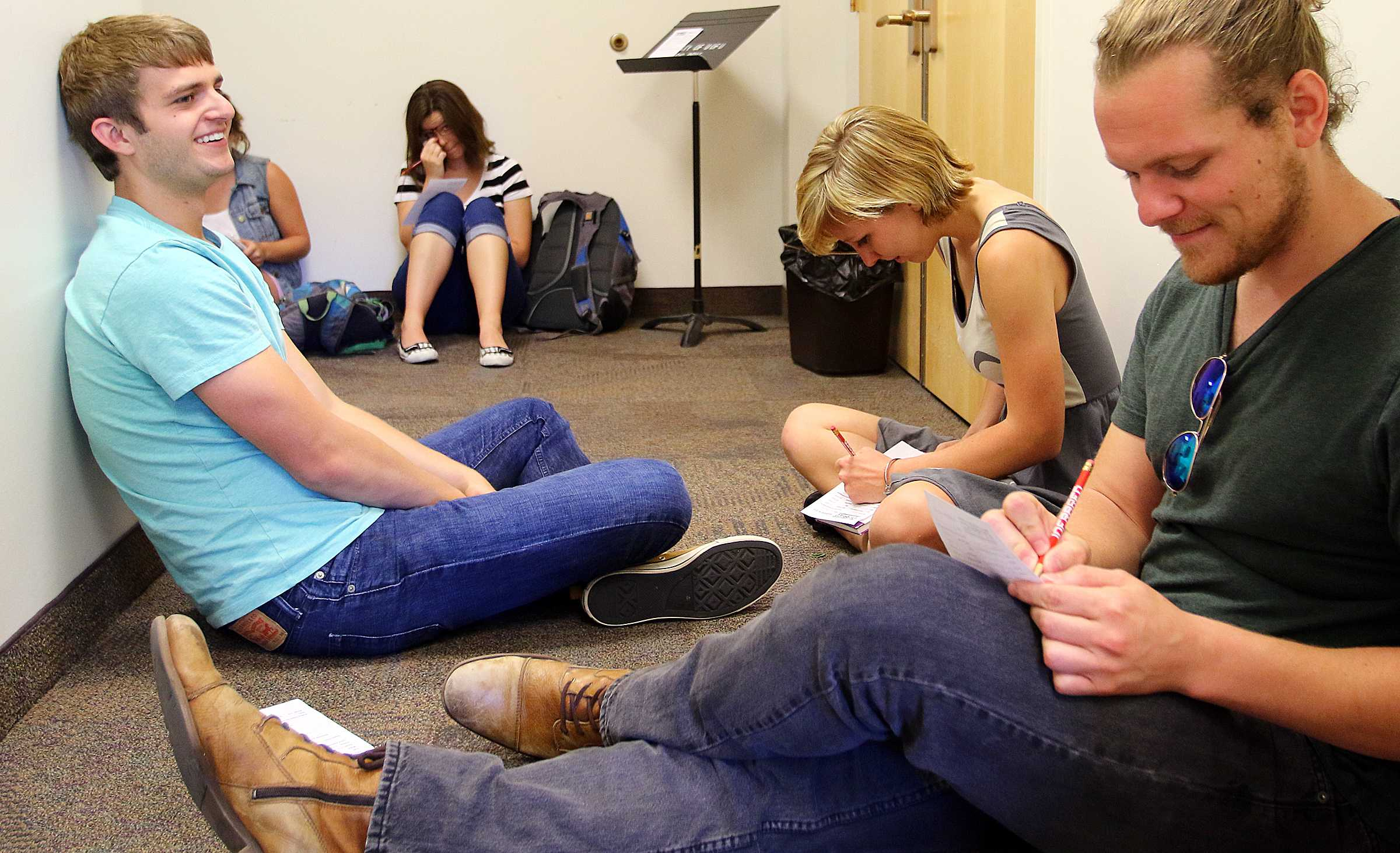 Students await their turn to audition for Infared, the U's acapella group, in Libby Gardner Hall, Friday, August 28, 2015.