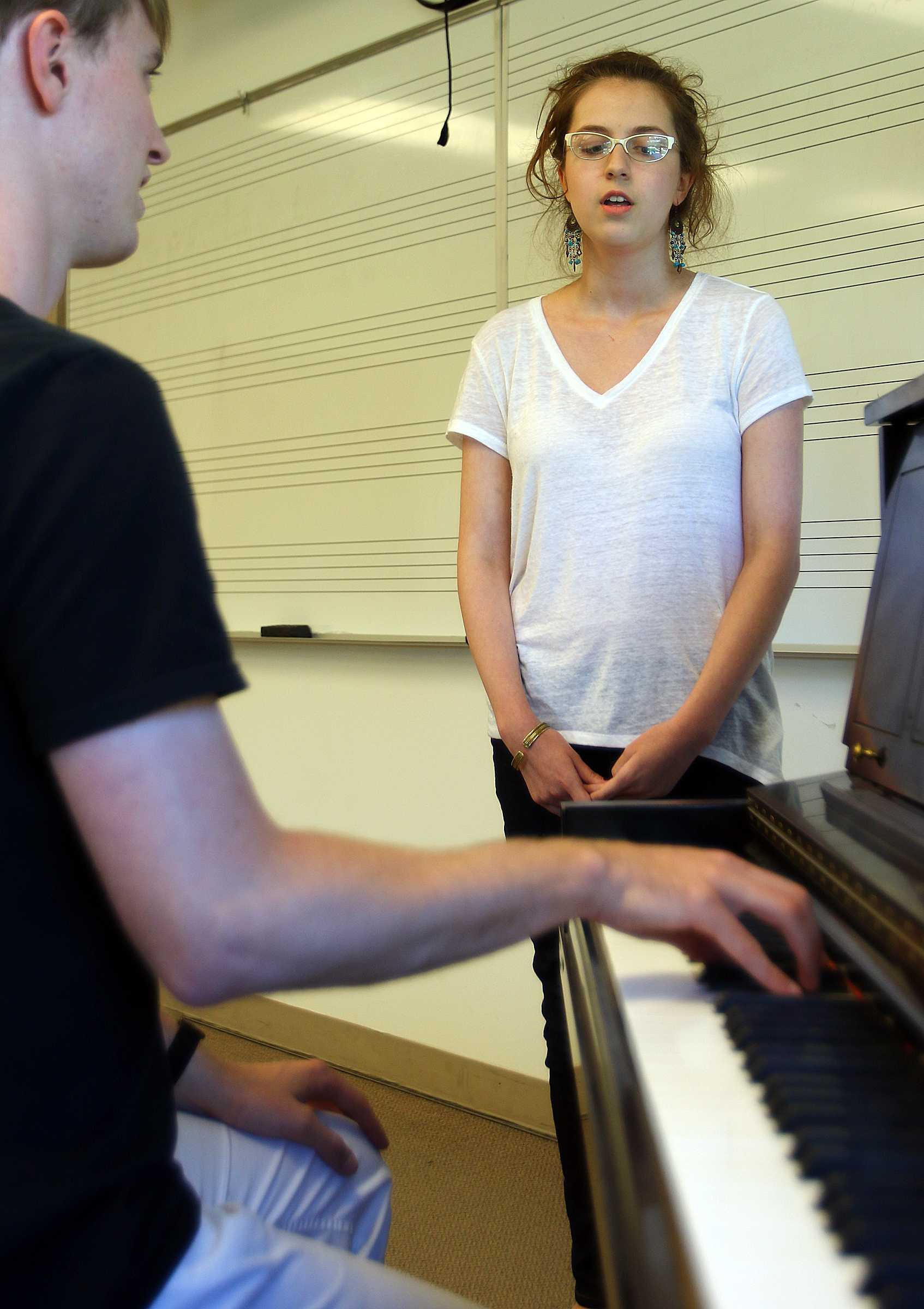 Michael Mitchell, a sophomore in piano performance, performs a scales exercise during an audition for Infared, the U's acapella group, in Libby Gardner Hall, Friday, August 28, 2015.