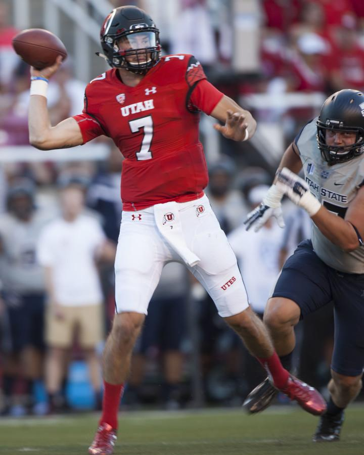 Senior quarterback Travis Wilson (7) throws the ball during a game against the the Utah State Aggies at Rice-Eccles Stadium, Friday, Sept. 11, 2015. Mike Sheehan, Daily Utah Chronicle.