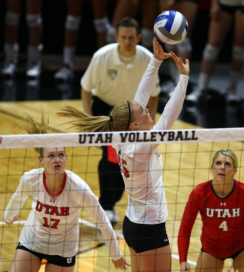 Freshman setter Jessie Jorgensen (15) sets the ball in the 2015 Utah Classic against the Idaho State Bengals in the Jon M. Huntsman Center, Friday, August 28, 2015. Photo credit: Chris Samuels