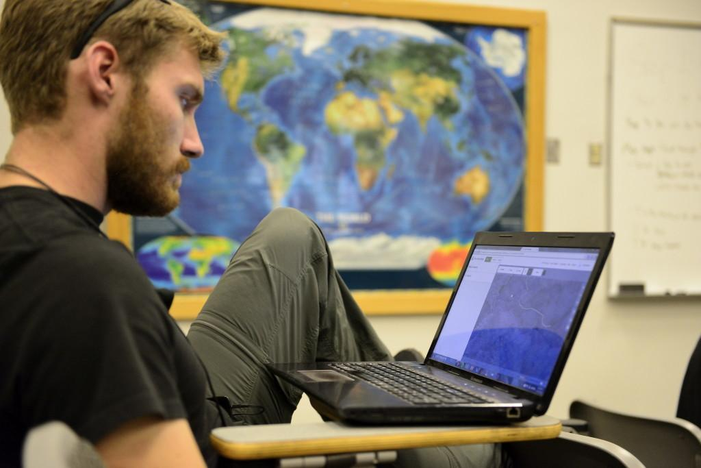 Cody Saylar, Junior in Mechanical Engineering, uses OpenStreetMaps to help map the Hurricane damaged region in Mexico in OSH on Monday, Oct. 26, 2015