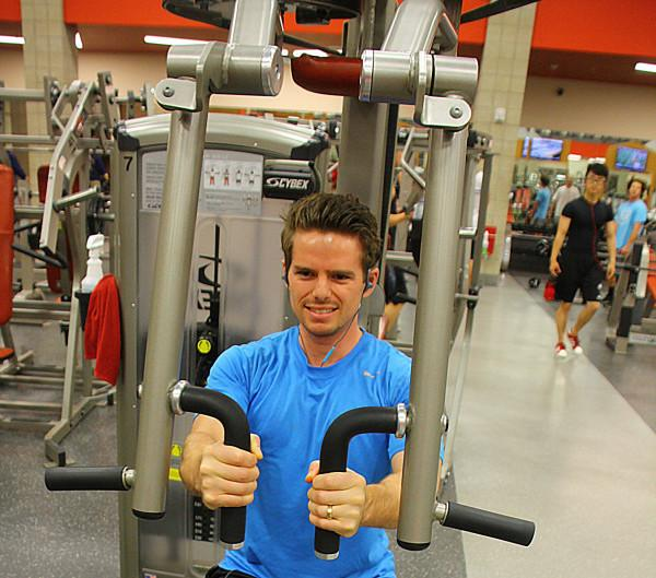 Brandon Hays, a junior in exercise and sports science pre med, works out at the Student Life Center on Wednesday night.