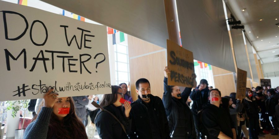 Protesters hold signs at a racial awareness march and discussion inside the Union Ballroom on Friday, Nov. 20th, 2015. Rishi Deka, Daily Utah Chronicle. (Rishi Deka, Daily Utah Chronicle)