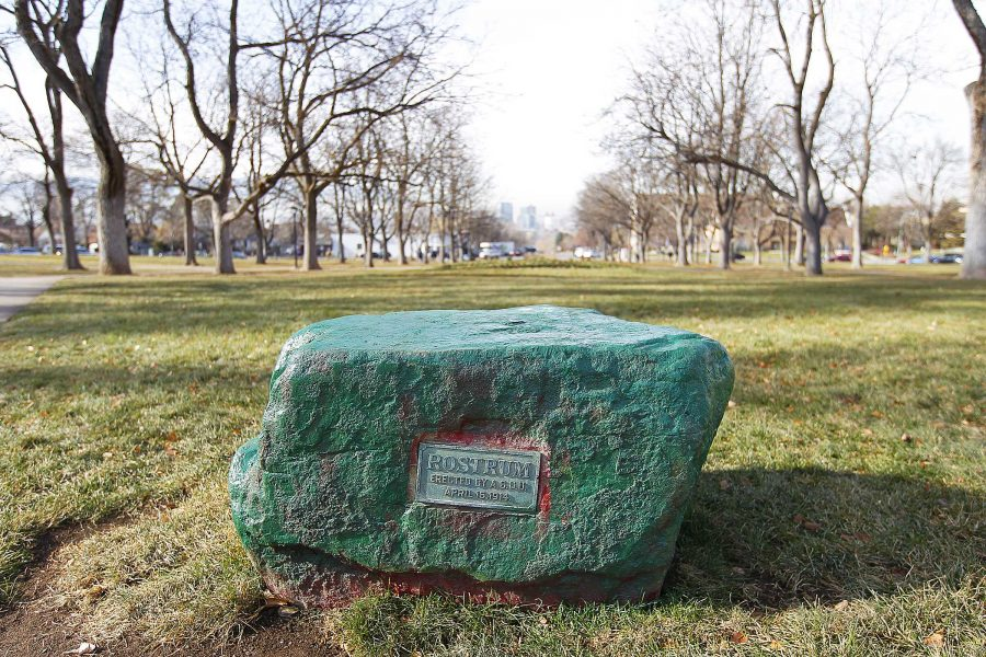 The Rostrum rock is painted green by vandalists at President's Circle. The Rostrum was placed in 1914 and was painted red. Photo credit: Chris Samuels