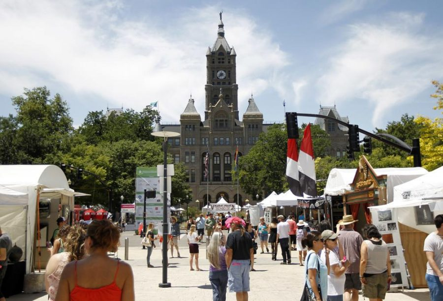 Visitors walk by artists booths and at the Utah Arts Festival in Salt Lake City, Saturday, June 27, 2015.