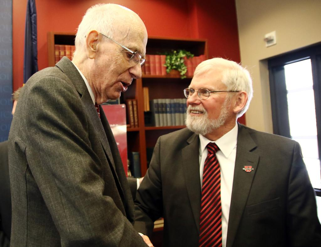 Former U.S. Senator Robert Bennett, left, shakes hands with U President David Pershing during a ceremony to induct senator Bennett into the Hinckley Institute of Politics Hall of Fame in the Hinckley Caucus Room in OSH, Wednesday, Jan. 27, 2016. Chris Samuels, Daily Utah Chronicle.