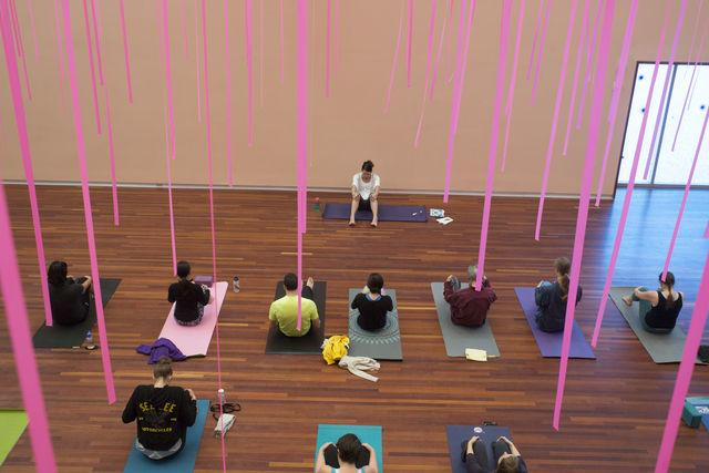 Vistors do yoga at the UMFA on Sunday, Jan 17, 2016. Photo by Chris Ayers.
