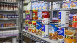 Shelves of food at the Feed U Pantry | Chronicle archives.