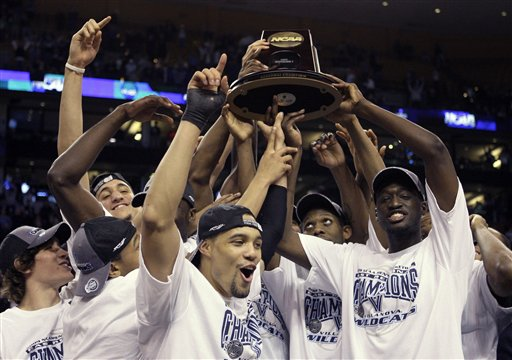 Villanova players celebrate with the trophy after defeating Pittsburgh, 78-76 during a men's NCAA tournament regional championship college basketball game in  Boston, Saturday, March 28, 2009. Villanova advances to the Final Four. (AP Photo/Elise Amendola)