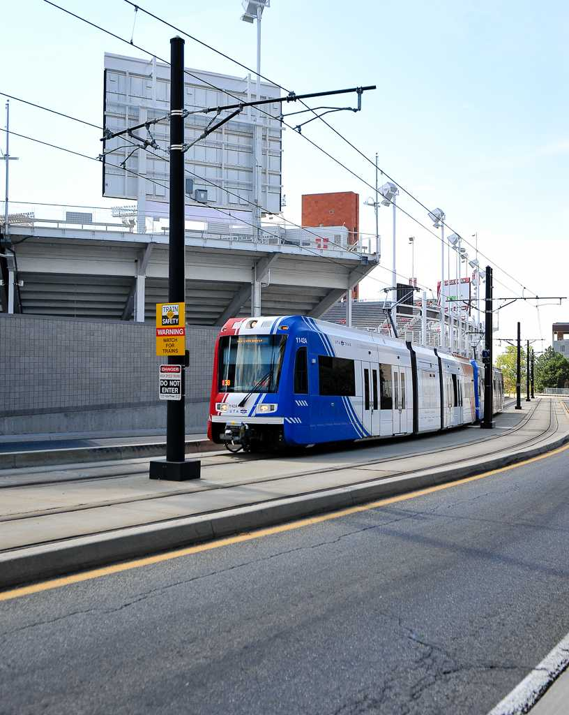 The Red-Line Traxx train heading up to the hospital passing underneath Rice-Eccles Stadium on Aug 30, 2016, Adam Fondren Daily Utah Chronicle
