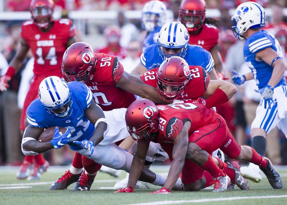 University of Utah Football defense tackles BYU running back Jamaal Willliams (21) during the game vs. the Brigham Young University Cougars at Rice-Eccles Stadium on Saturday, September 10, 2016