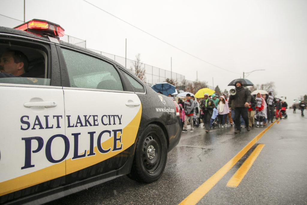 Salt Lake City police escort marchers during a rally and march commemorating Martin Luther King, Jr. Day along 1300 East in Salt Lake City, Monday, Jan. 18, 2016.