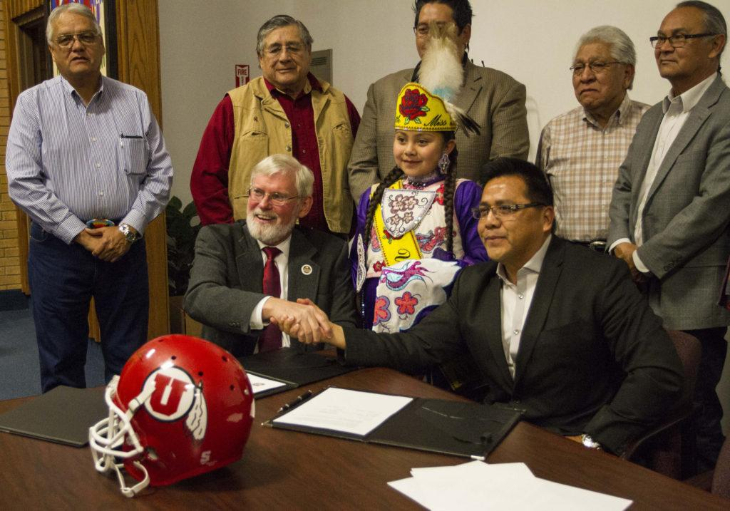 Left to Right President Pershing and Chairmen Gordon Howell, and members of the Ute Indian Tribe Business Committee shake hands after the signing of the Memoradium of Understanding at the Ute Indian Tribe Headquaters in Fort Duchesne, Utah.