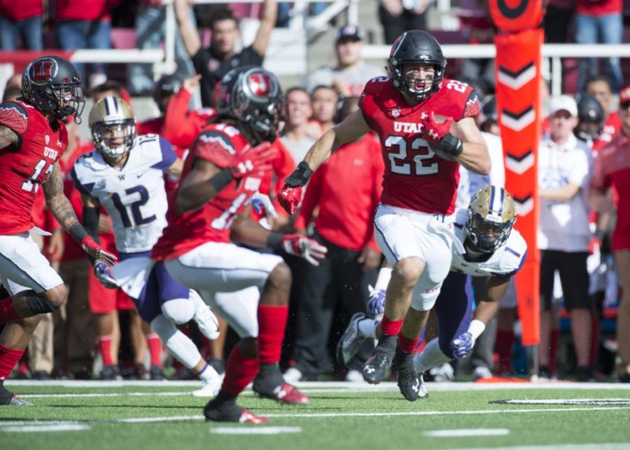 Utah Football sophomore strong safety Chase Hansen (22) makes an interception and runs the ball 30 yards during the game vs. the Washington Huskies at Rice-Eccles Stadium on Saturday, October 29, 2016
