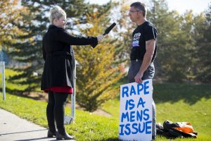 A man is interviewed during the sexual assault protest in the MEB parking lot on Friday, Nov 4, 2016. Chris Ayers Daily Utah Chronicle.