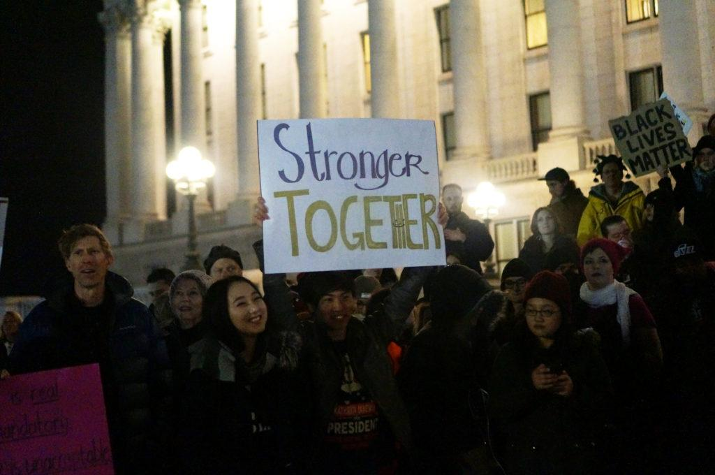 A man holds a Stronger Together sign in front of the Utah State Capitol during President Trump's Inauguration Day protests in Salt Lake City, Utah on Friday, Jan. 20, 2017. (Rishi Deka, Daily Utah Chronicle)