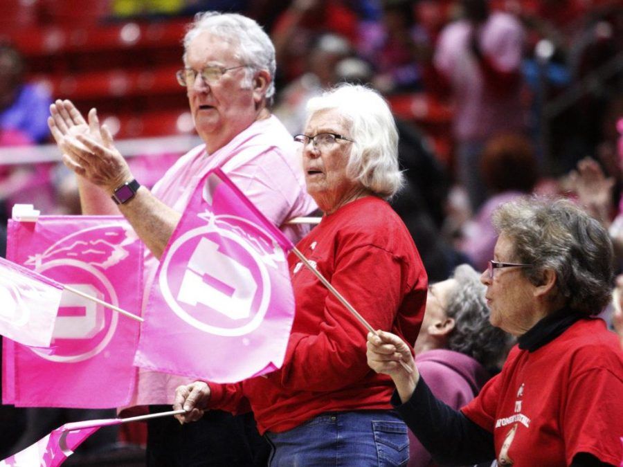 Utah fans wave pink flags during the start of the Utah Utes Women's Basketball annual