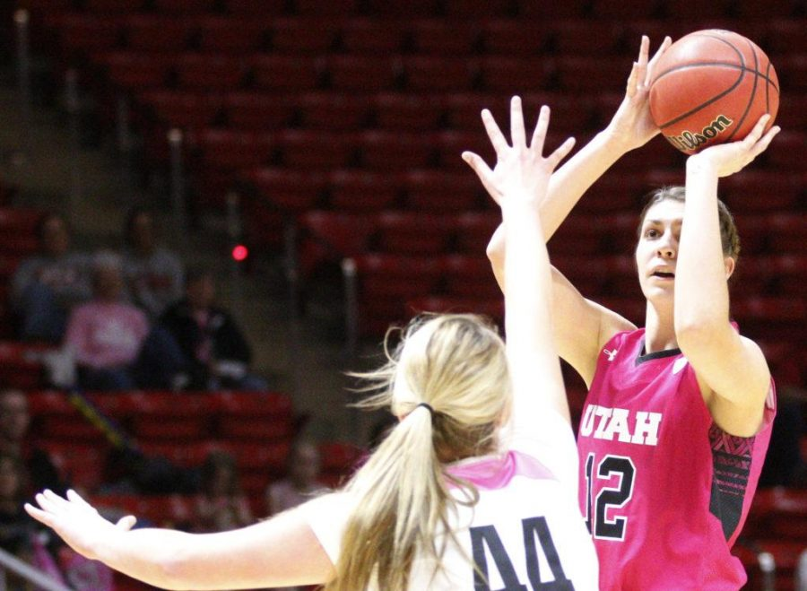 Ute Forward Emily Potter (12) attempts a three point shot over Duck Forward Mallory McGwire (44) during the Womens annual  Pink Game vs. the Oregon Ducks at the Huntsman Center in Salt Lake City, Utah on Friday, Feb. 17, 2017. (Rishi Deka, Daily Utah Chronicle)
