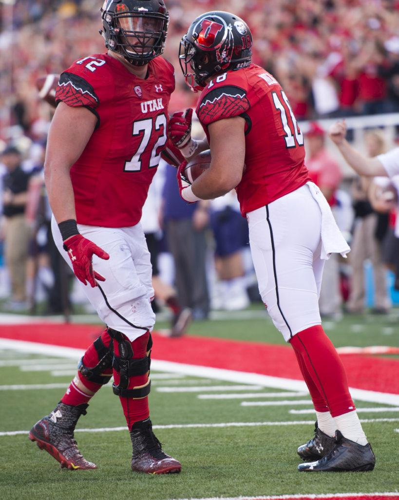 Utah Football senior tight end Evan Moeai (18) celebrates with teammate junior offensive line Garett Bolles (72) during the game vs. the Washington Huskies at Rice-Eccles Stadium on Saturday, October 29, 2016