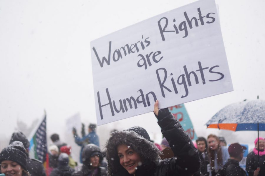 A woman holds a Womens Rights are Human Rights sign during Womens March on the Utah State Capitol in Salt Lake City, Utah on Monday Jan. 23, 2017. (Rishi Deka, Daily Utah Chronicle)