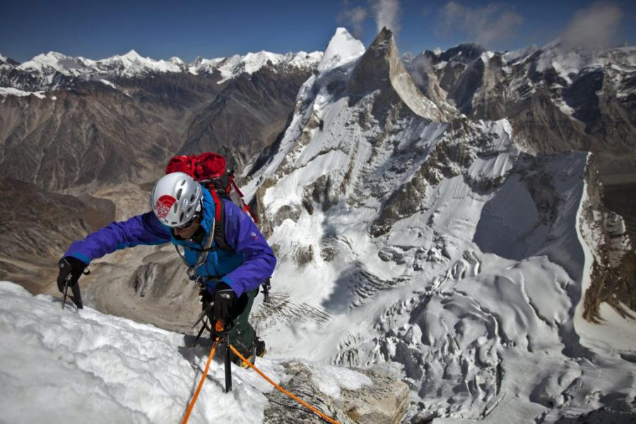 Conrad Anker geared up and climbing out near the teams highest portaledge camp at over 20,000ft.
