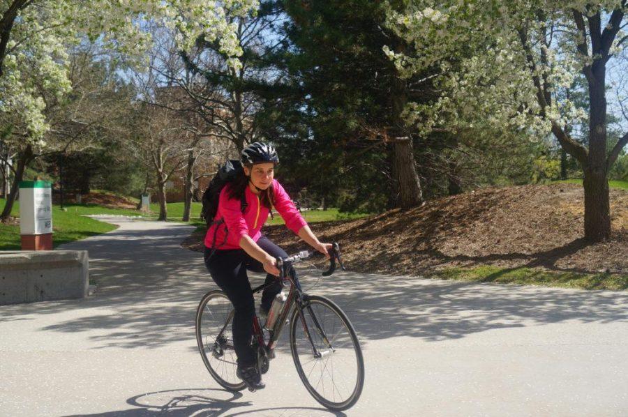 University of Utah faculty and pharmacy student Hillevi Bauer rides her bike near the Merrill Engineering Building at the U in Salt Lake City, Utah on Wednesday, Apr. 12, 2017. (Rishi Deka, Daily Utah Chronicle)