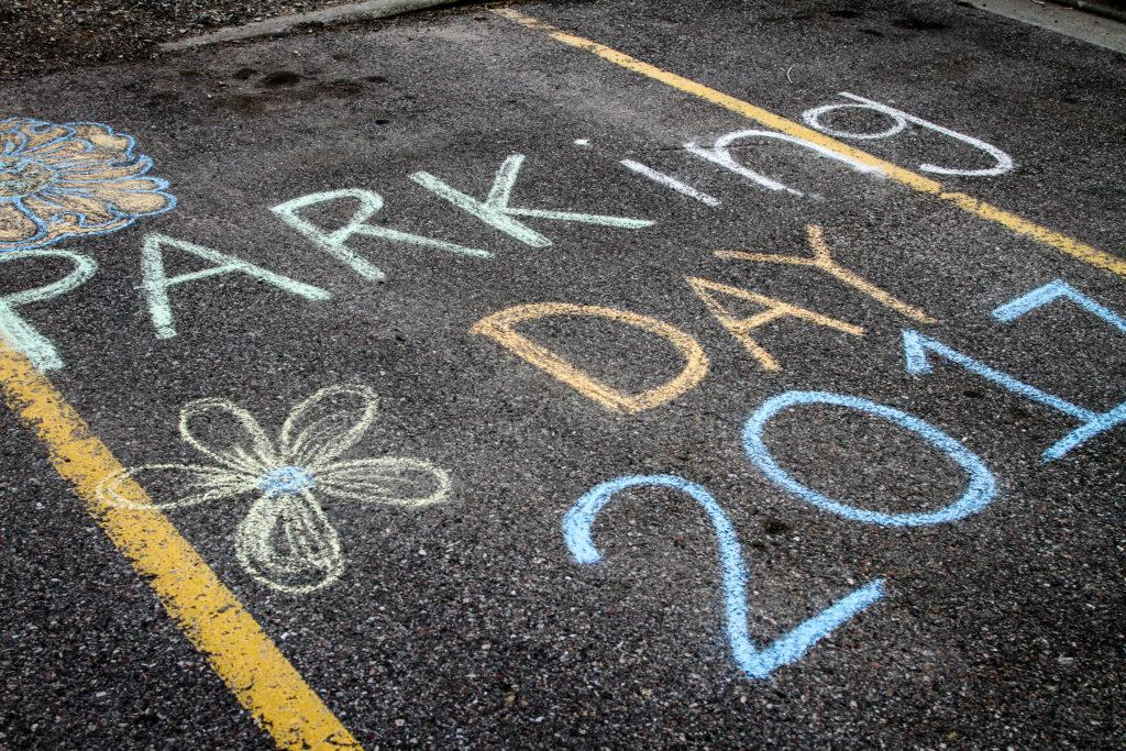 Sidewalk chalk messages at the SCAPE paraking event in the Marriott Library parking lot Apr. 11, 2017. Adam Fondren For the Daily Utah Chronicle.