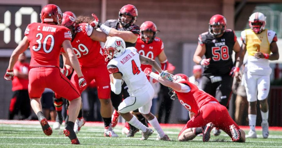 Senior Troy McCormick Jr. (4) sheds a tackle during the University of Utahs Red and White football game on Apr. 15, 2017 at Rice Eccles Stadium, Salt Lake City, UT  Photo by Adam Fondren/Daily Utah Chronicle