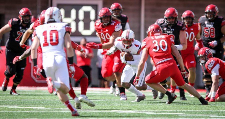Senior Troy McCormick Jr. (4) running the ball during the University of Utahs Red and White football game on Apr. 15, 2017 at Rice Eccles Stadium, Salt Lake City, UT  Photo by Adam Fondren/Daily Utah Chronicle