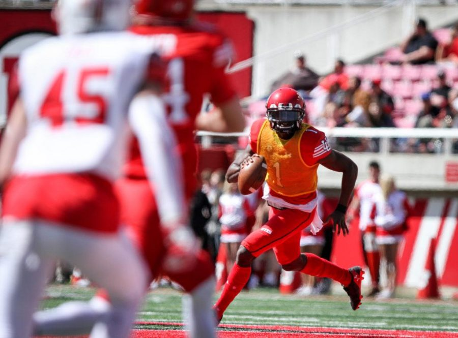 Sophmore Tyler Huntley (1) takes off running at the University of Utah's Red and White football game on Apr. 15, 2017 at Rice Eccles Stadium, Salt Lake City, UT  Photo by Adam Fondren/Daily Utah Chronicle
