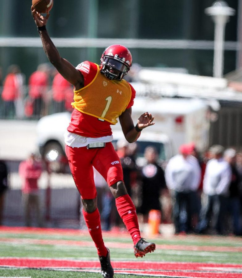 Sophmore Tyler Huntley (1) heaves the ball downfield at the University of Utahs Red and White football game on Apr. 15, 2017 at Rice Eccles Stadium, Salt Lake City, UT  Photo by Adam Fondren/Daily Utah Chronicle