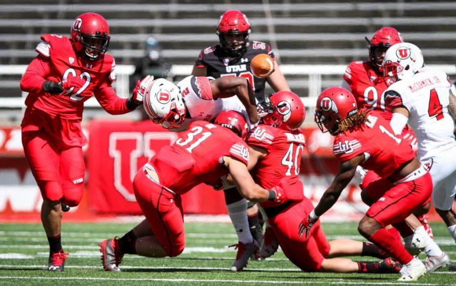 Sophmore Zack Moss (2) fumbles the ball at the University of Utahs Red and White football game on Apr. 15, 2017 at Rice Eccles Stadium, Salt Lake City, UTPhoto by Adam Fondren/Daily Utah Chronicle