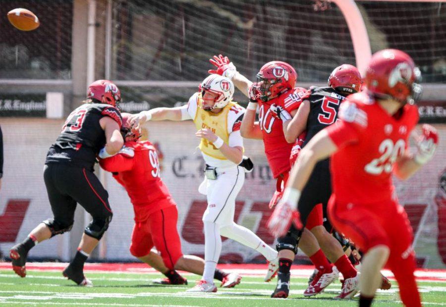 Freshman Drew Lisk (14) passes the ball downfield during the University of Utahs Red and White football game on Apr. 15, 2017 at Rice Eccles Stadium, Salt Lake City, UTPhoto by Adam Fondren/Daily Utah Chronicle