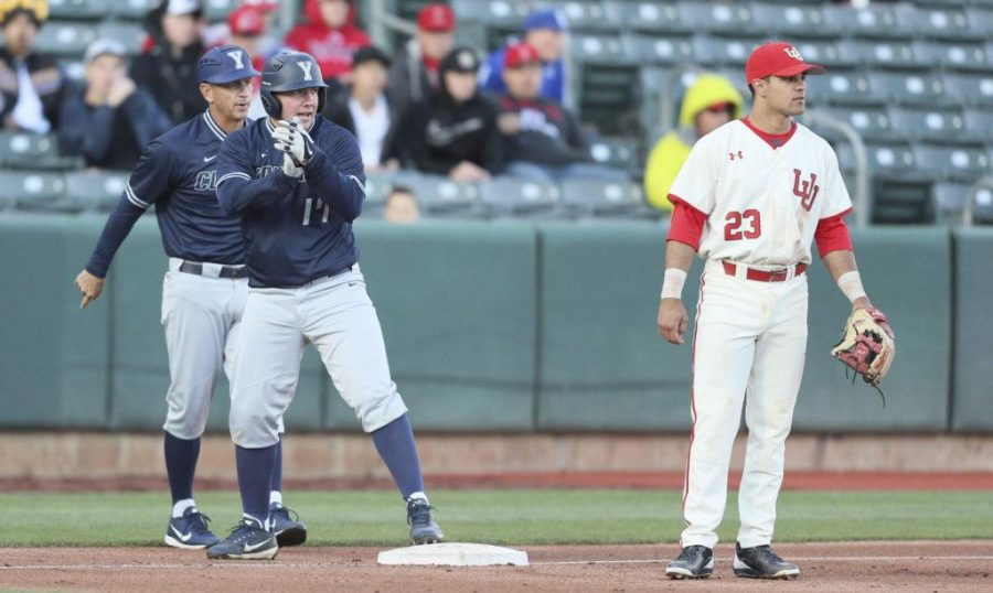 BYU outfielder Keaton Kringlen (17) after hitting an RBI triple in the top of the second to extend their lead against Utah 7-2 at Smiths Ballpark on Tuesday, March 28, 2017. (Chris Ayers|Daily Utah Chronicle.)