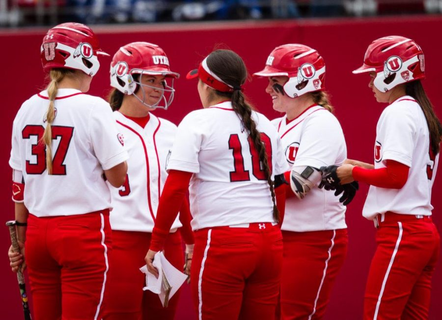 University of Utah Womens Softball Team gathers to discuss strategy during a break in action in an NCAA Regional Game vs. The Brigham Young University Cougars at Dumke Family Softball Stadium, Salt Lake City, UT on Friday, May 19, 2017(Photo by Adam Fondren | Daily Utah Chronicle)