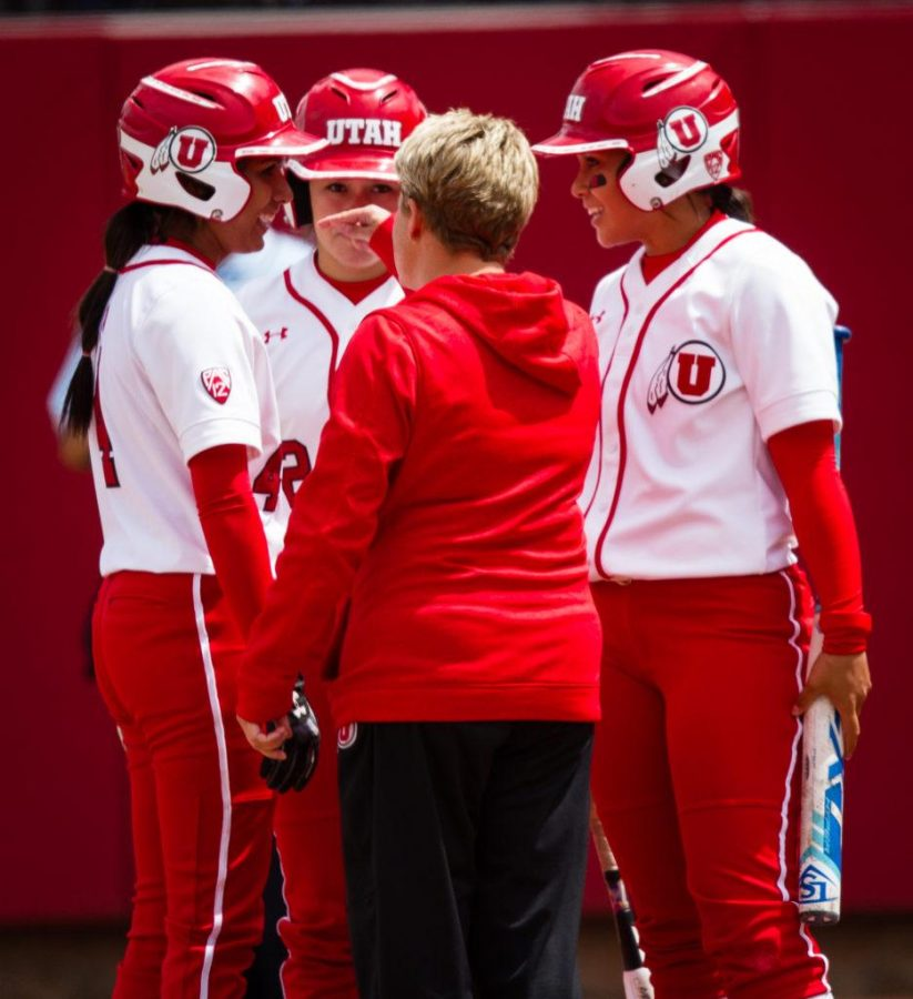 University of Utah Womens Softball Team head coach Amy Hogue speaks with her players during the rally in the bottom of the 7th in an NCAA Regional Game vs. The Brigham Young University Cougars at Dumke Family Softball Stadium, Salt Lake City, UT on Friday, May 19, 2017  (Photo by Adam Fondren   Daily Utah Chronicle)