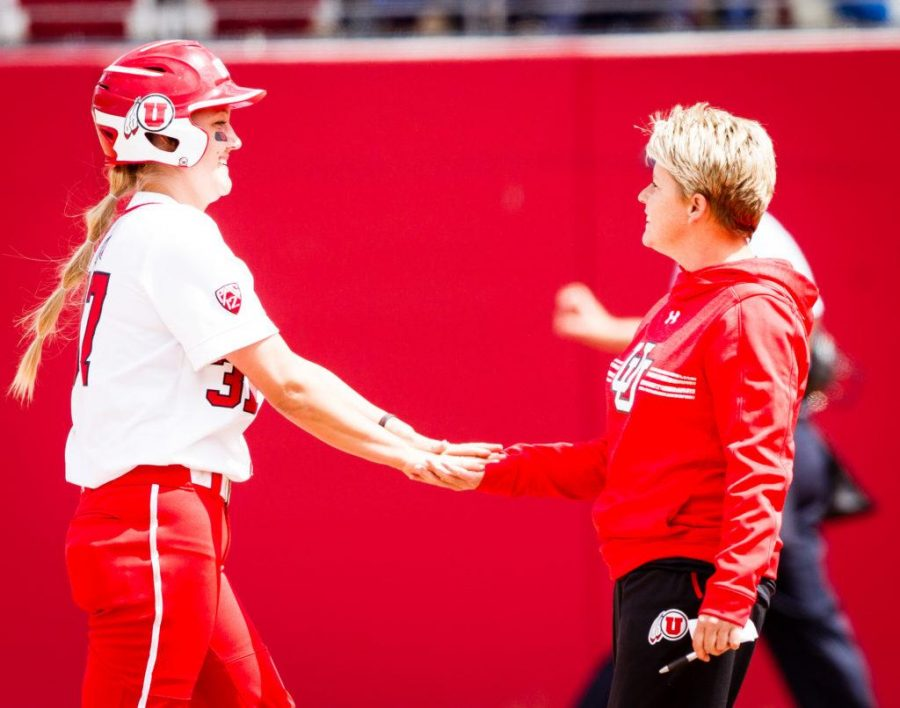 University of Utah Womens Softball Team junior 3rd/1st baseman Heather Bowen (37) is congratulated by head coach Amy Hogue for her game tying RBI in the bottom of the 7th in an NCAA Regional Game vs. The Brigham Young University Cougars at Dumke Family Softball Stadium, Salt Lake City, UT on Friday, May 19, 2017  (Photo by Adam Fondren   Daily Utah Chronicle)