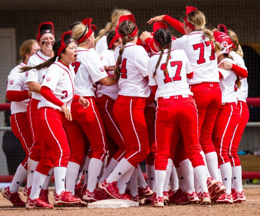 With rally caps donned the University of Utah Womens Softball Team reacts to winning the game in the bottom of the 7th in an NCAA Regional Game vs. The Brigham Young University Cougars at Dumke Family Softball Stadium, Salt Lake City, UT on Friday, May 19, 2017  (Photo by Adam Fondren   Daily Utah Chronicle)