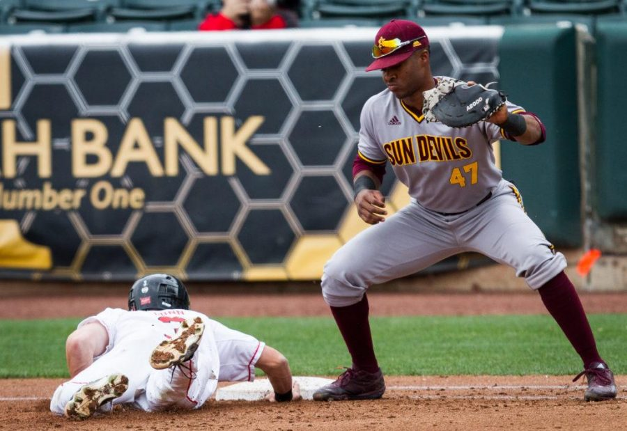 University of Utah Baseballs freshman infielder Oliver Dunn (3) dives safely back into first just ahead of the throw to Arizonas junior infielder Taylor Lane (47) in an PAC 12 Game vs. The Arizona State Sun Devils at The Salt Lake Bees Stadium, Salt Lake City, UT on Friday, May 26, 2017(Photo by Adam Fondren   Daily Utah Chronicle)