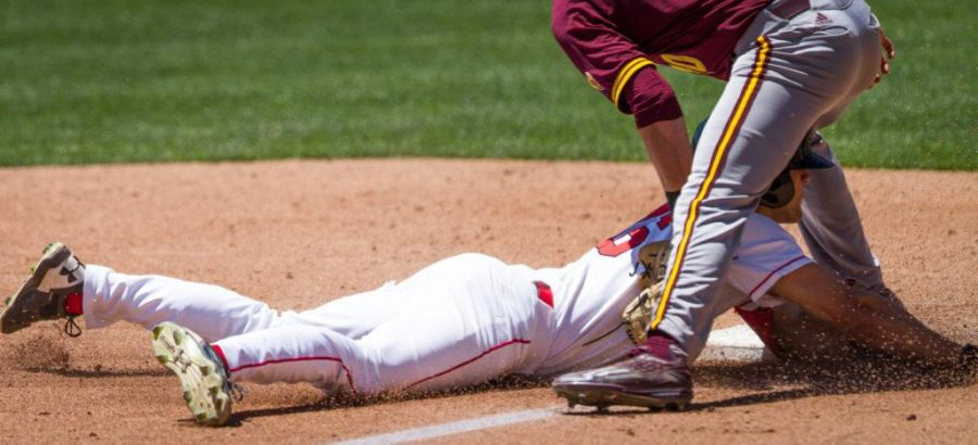 University of Utah Baseballs sophomore outfielder Chandler Anderson (16) slides in under the legs of Arizona States sophomore infielder Jeremy McCuin (10) during a PAC 12 Game vs. The Arizona State Sun Devils at The Salt Lake Bees Stadium, Salt Lake City, UT on Saturday, May 27, 2017(Photo by Adam Fondren   Daily Utah Chronicle)