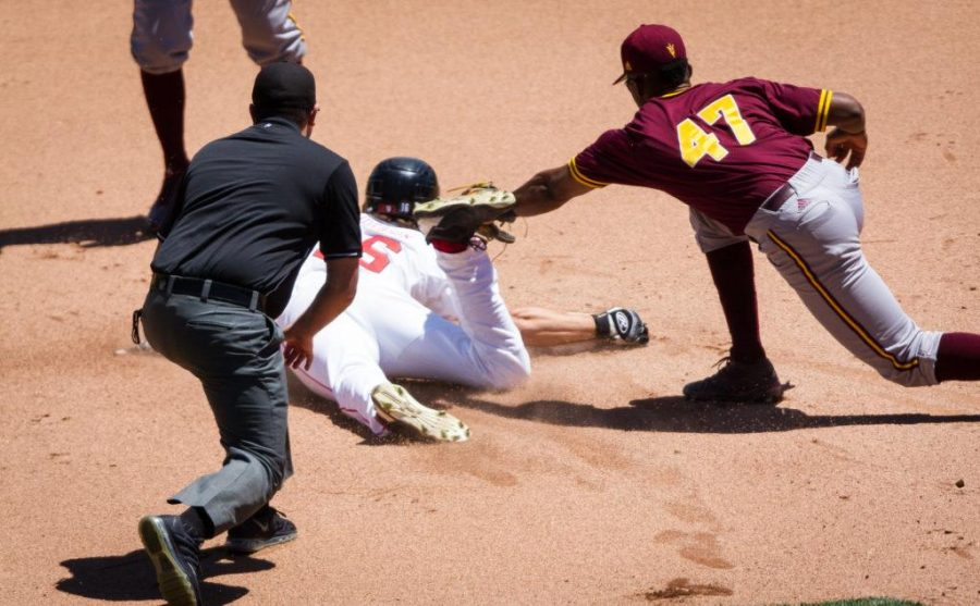 University of Utah Baseballs sophomore outfielder Chandler Anderson (16) attempts to slide under the tag of Arizona States junior infielder Taylor Lane (47) in an PAC 12 Game vs. The Arizona State Sun Devils at The Salt Lake Bees Stadium, Salt Lake City, UT on Saturday, May 27, 2017(Photo by Adam Fondren   Daily Utah Chronicle)